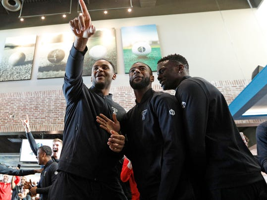 Texas Tech's Tommy Hamilton, Niem Stevenson and Norense Odiase celebrate after finding out where the Red Raiders will play during a watch party for the NCAA basketball tournament Sunday, March 11, 2018, in Lubbock, Texas. (Brad Tollefson/Lubbock Avalanche-Journal via AP)