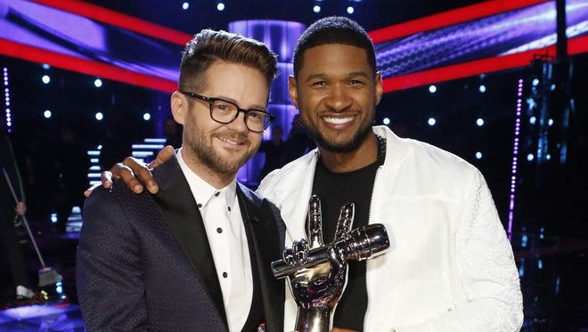"""Josh Kaufman, left, poses with Usher after the singer and coach won """"The Voice"""" competition in May."""
