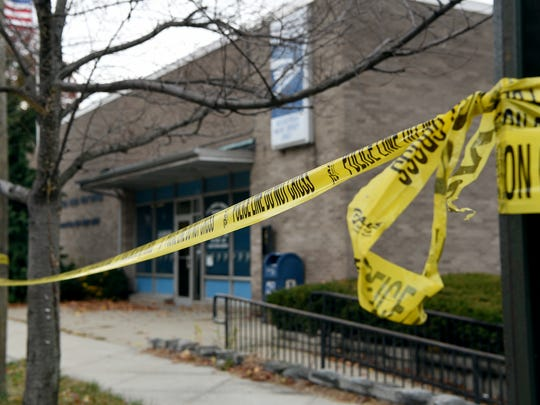 Members of the Bergen County Prosecutor's Office investigate