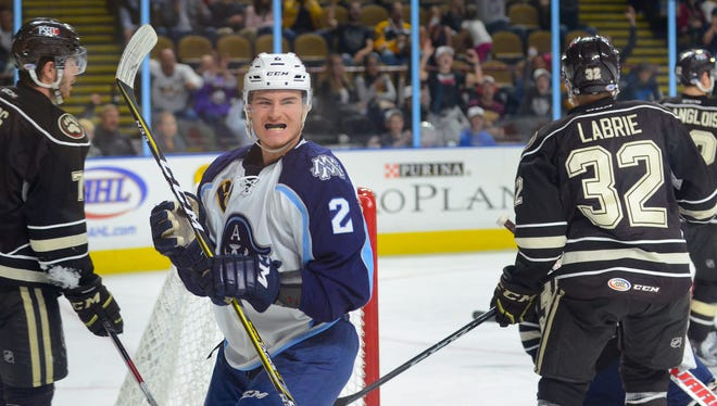 Milwaukee Admirals right wing Tyler Moy celebrates his first goal of the season, a second-period score that gave the Admirlals a 2-1 lead over Hershey on Friday, Oct. 20, at the UW-Milwaukee Panther Arena. The Admirals beat the Bears, 4-1, in their home opener.