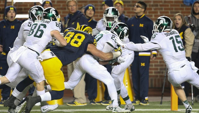 Michigan State's Jalen Watts-Jackson runs back a muffed punt to beat Michigan Sunday in Ann Arbor.