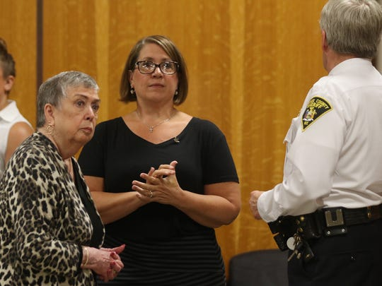 Ness Rideout, Craig Rideout's mother, and her daughter, Robbyn Drew,  wait with Monroe County Sheriff Patrick O'Flynn for the doors to open to hear the verdict.