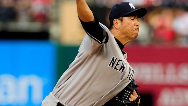 Yankees starting pitcher Hiroki Kuroda throws during the first inning at Busch Stadium.