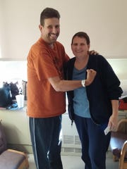 Eric Amshoff after he had both of his kidneys removed. Jerri Kurdila, a co-worker, donated one of hers.