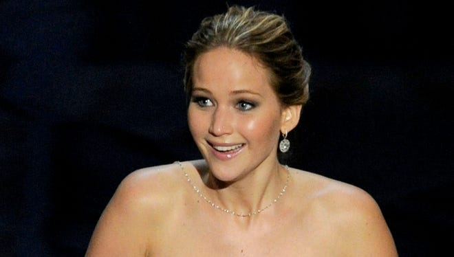Jennifer Lawrence accepts the award for best actress in a leading role for 'Silver Linings Playbook.'