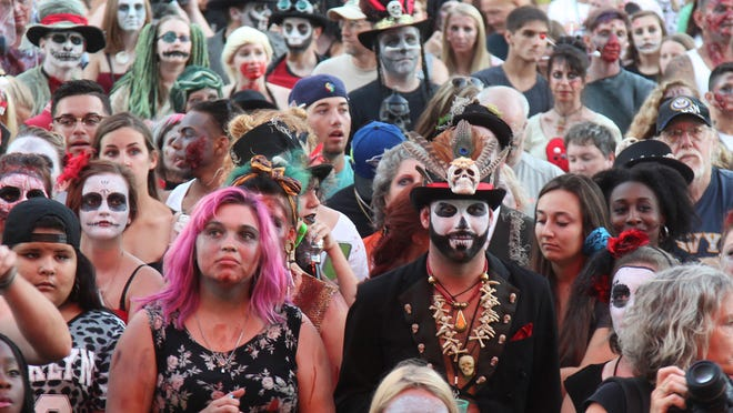 Visitors to downtown Fort Myers gather in front of the Sydney & Berne Davis Art Center for the costume contest.