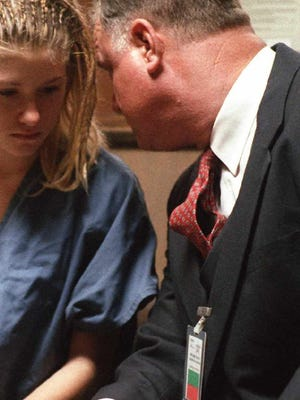 FILE: Sam Bardwell  talks to a client during her hearing in  court.
