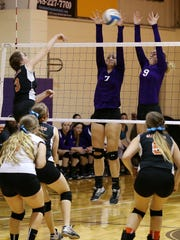 Jumping in tandem to block a kill attempt by Huron