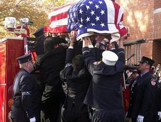 The casket containing the body of New York City Fire