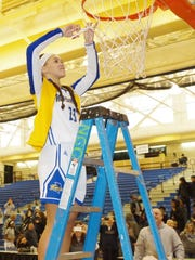RCGC's Autumn Ingram cuts down the nets following the Roadrunners' championship on Sunday.