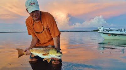 PIC OF THE WEEK: Wild Fly Charters Capt. Gregg McKee recently beat the heat, and this nice redfish caught last Thursday evening in northern Matlacha Pass, one of many productive areas for reds.