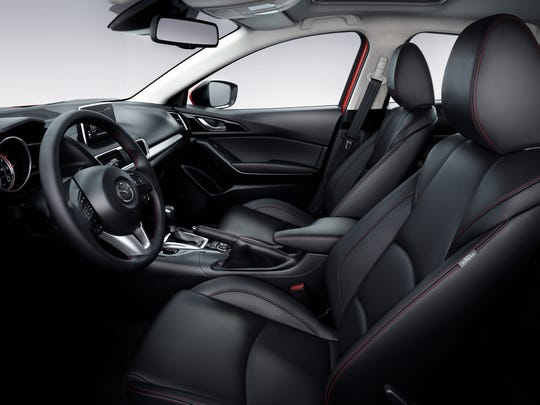 The 2014 Mazda3 offers heated leather seats,  and everything else is padded, leather-wrapped, pseudo carbon-fibered or piano black.