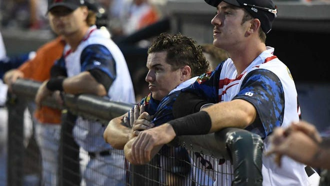 Cadyn Grenier (center) watches from the Delmarva Shorebirds' dugout on July 4 during the team's game against the Hagerstown Suns.