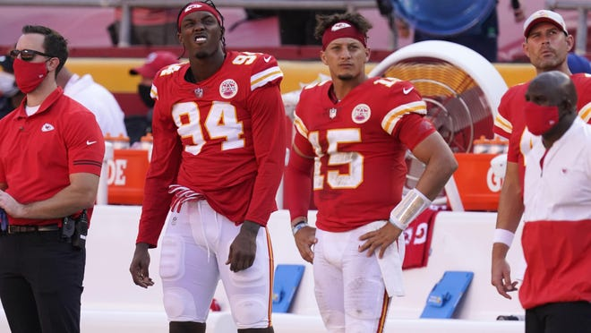 Kansas City Chiefs defensive end Taco Charlton (94) and quarterback Patrick Mahomes (15) watch from the bench during the second half of Sunday's 40-32 loss to the Raiders.