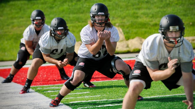 St. Cloud State offensive lineman Karl Eichinger (67) works through a drill during the opening day of practice on Thursday at Husky Stadium.