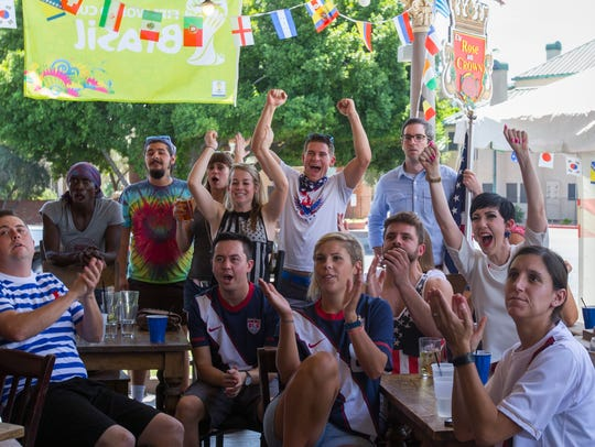 Fans react to World Cup game action in the USA v. Germany match at The Rose & Crown Pub in Phoenix on June 26, 2014.