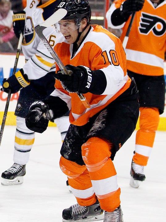 Philadelphia Flyers' Brayden Schenn reacts after scoring during the second period of an NHL hockey game against the Buffalo Sabres, Sunday, April 6, 2014, in Philadelphia. (AP Photo/Tom Mihalek)