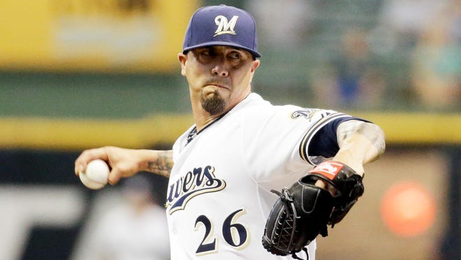 Milwaukee Brewers starting pitcher Kyle Lohse throws during the first inning against the Atlanta Braves on Monday, July 6, 2015, in Milwaukee.