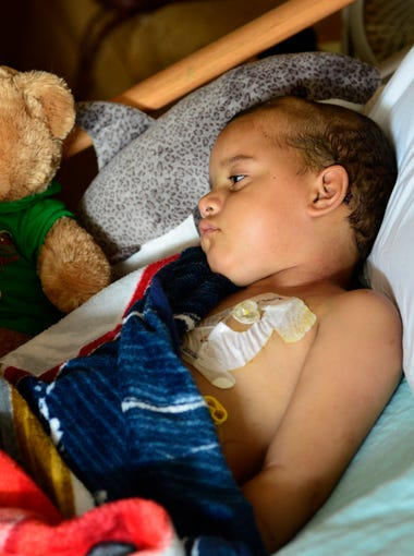 Tae Smith, 5, rests at a hospice center in Sandusky after spending 16 months in treatments, doctor visits, clinical trials and chemotherapy sessions at different children's hospitals in Cleveland, Philadelphia and Cincinnati. He had been treated for glioblastoma, an aggressive brain cancer with a low survival rate, generally considered incurable.
