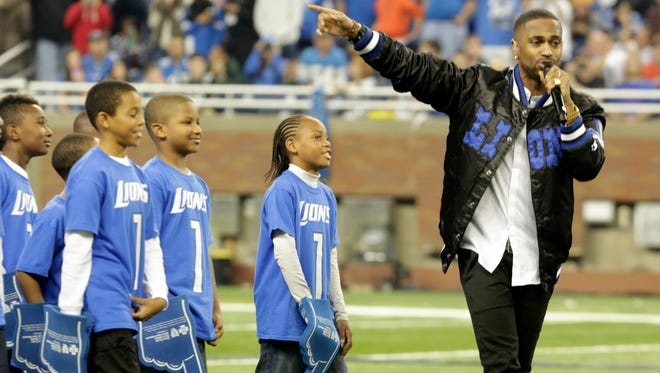 Big Sean performs during halftime of Thursday's game at Ford Field.