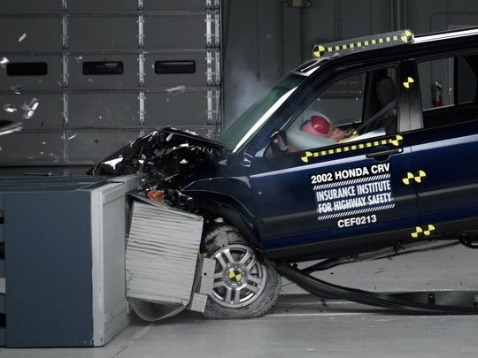 A crash test of a 2002 Honda CR-V, one of the models subject to a recall to repair faulty air bags. The recalls haven't hurt Honda sales.