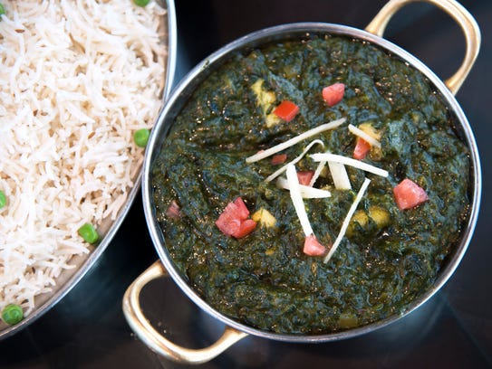 Fresh Saag Paneer and rice are a traditional pairing at Monsoon Fine Indian Cuisine in Cherry Hill.