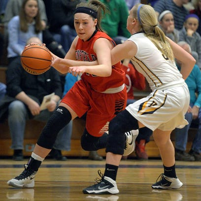 Kristen Baumer, shown here driving the baseline in a win over Victor on Feb. 2, is one of the key players for Penfield, the top seed in the Class AA tournament.