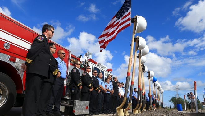Corpus Christi fire fighters gather during the groundbreaking of the construction of Fire Station #18 on Wednesday, Oct. 19, 2016, on Ayers St. in Corpus Christi.