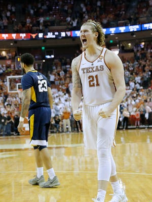 Dylan Osetkowski of the Texas Longhorns reacts as his team defeats the West Virginia Mountaineers 87-79 in overtime at the Frank Erwin Center on March 3, 2018 in Austin, Texas.