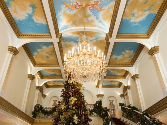 The ceiling in the foyer was painted by John Woodrow Kelley in his Brooklyn studio. The panels were brought to Knoxville for installation.