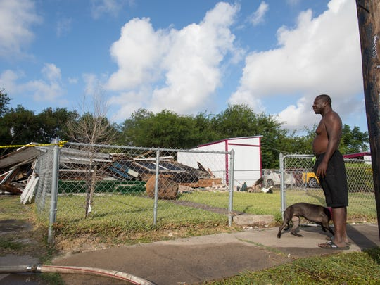 Robert Moore stops to look at the rubble at 2409 West Broadway St. in the Hillcrest neighborhood Wednesday, July 19, 2017, after the house on the lot was demolished. This is the first home to be demolished by the Port of Corpus Christi ahead of the Harbor Bridge replacement project.