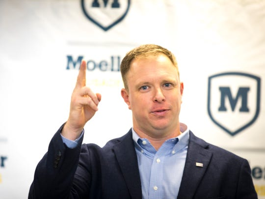 Mon., Dec. 4, 2017: Doug Rosfeld, one of the 1996 captains of the Moeller High School Crusaders, speaks to the press and to his supporters after he was named the school's sixth head football coach. He returns to the high school ranks after spending three seasons as the Director of Player Development for University of Cincinnati football. Rosfeld was previously a Moeller offensive line coach and history teacher before joining UC.