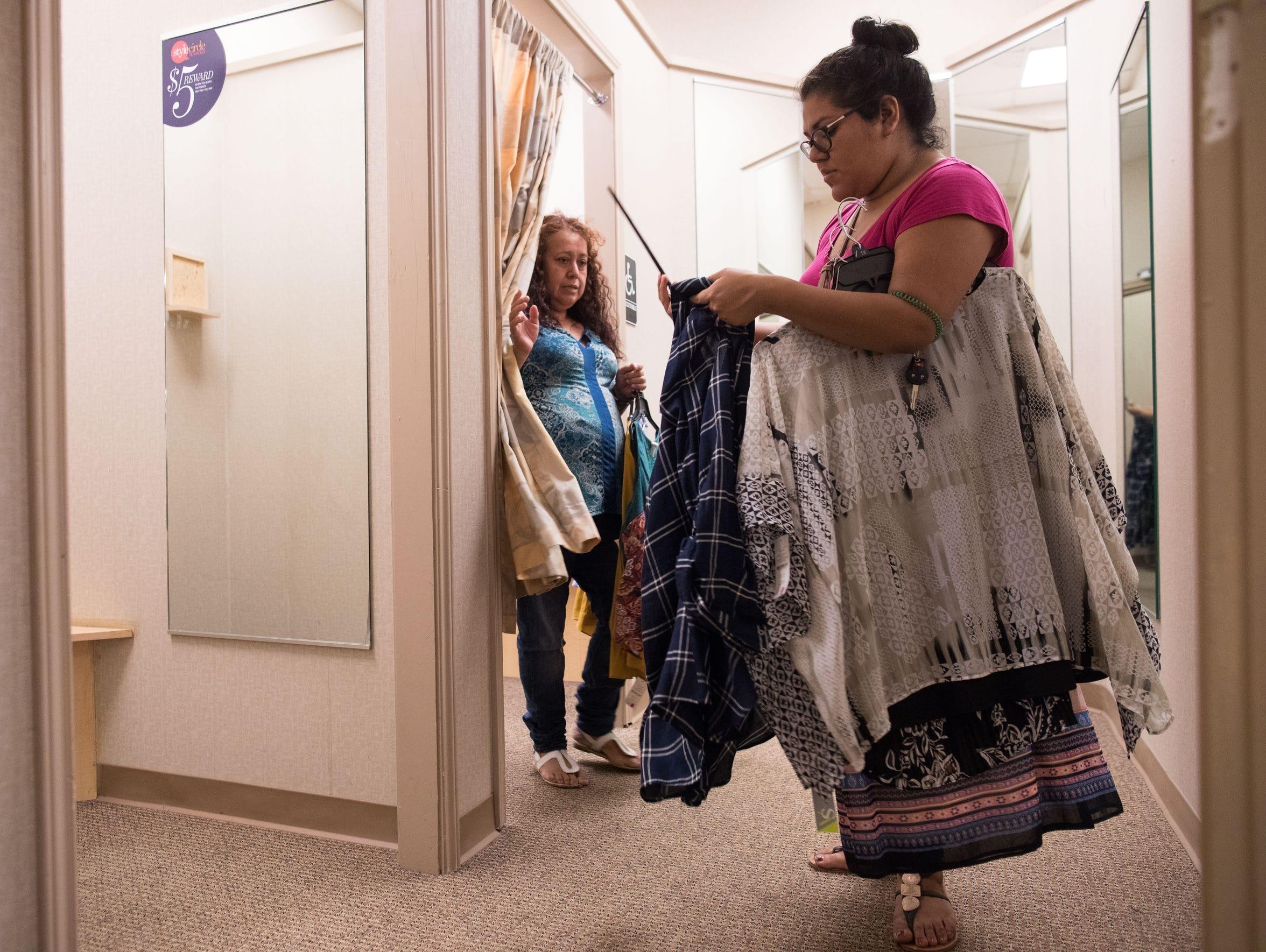 Maria Hernandez helps her mother Carlota Palomo pick