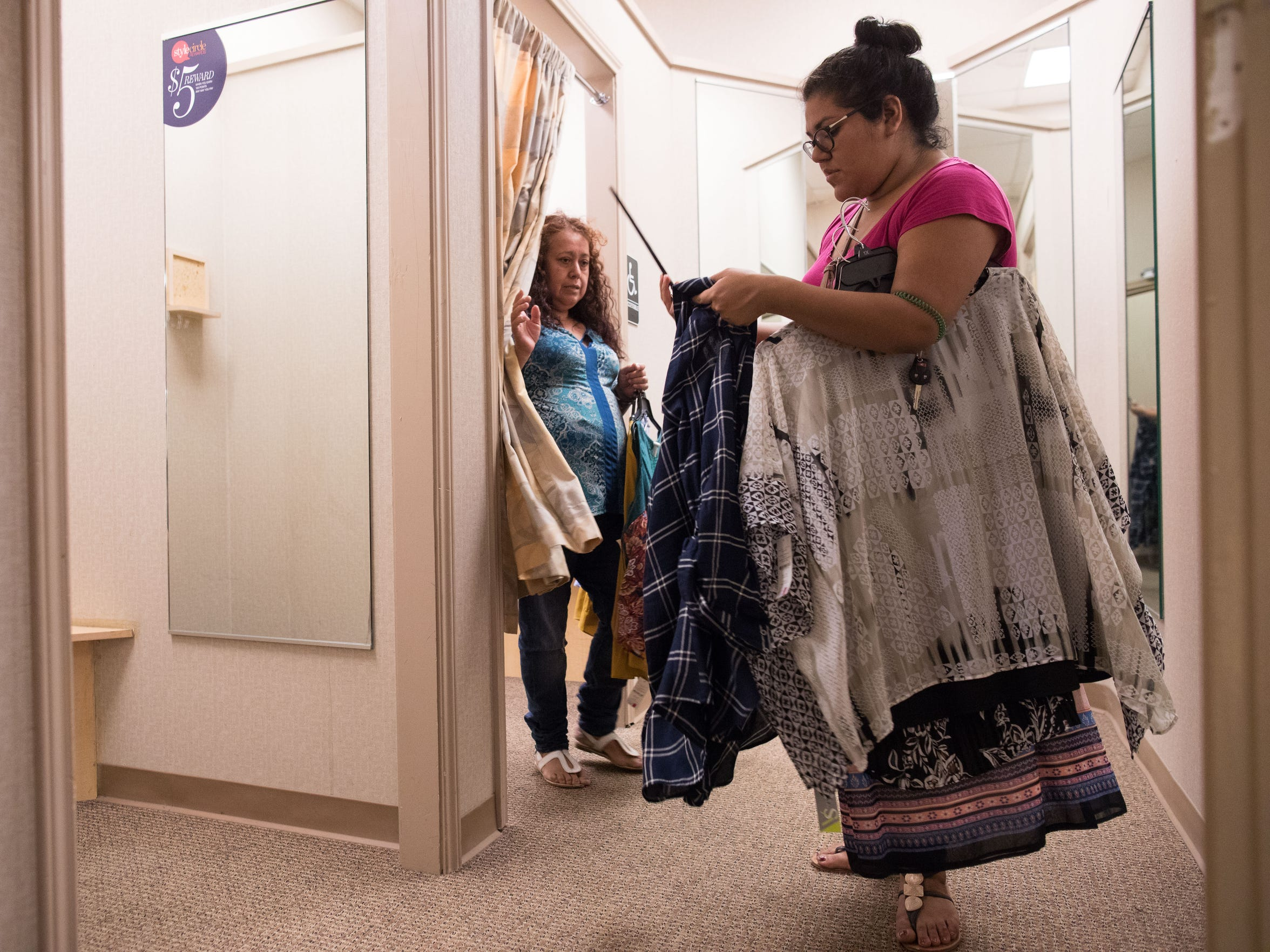 Maria Hernandez helps her mother Carlota Palomo pick out a dress for her 50th birthday party on Saturday, Nov. 4, 2017.  Hernandez is a DACA recipient who was brought to the U.S from Mexico at the age of 4 by her grandmother to escape an abusive father.