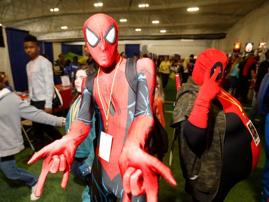 Fans dress as Spider-Man, center, and Deadpool, right, at the 2018 Hudson Valley Comic Con at the Gold's Gym in LaGrange.