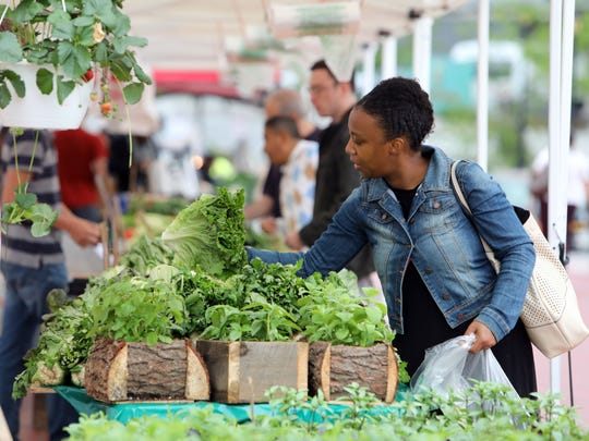 Nensha Basshan of White Plains shops for lettuce from the Rolling Ridge Farms vendor, which is located in Mifflinburg, PA, at the White Plains farmers market May 16, 2018. Basshan said she feels safe buying lettuce from them because she knows where it's coming from.