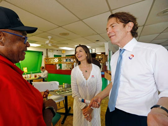 Howard Sherman, right, who came in first in the six-candidate Democratic primary June 5, 2018, for his party's nomination for the U.S. Senate seat held by Republican Roger Wicker, and his wife, actress Sela Ward, discuss election issues in a Jackson, Miss., soul food restaurant, with customer Earnest Clincy during a working lunch on election day. He and state Rep. David Baria will face off in Tuesday's  primary runoff to see who wins the nomination. (AP Photo/Rogelio V. Solis)