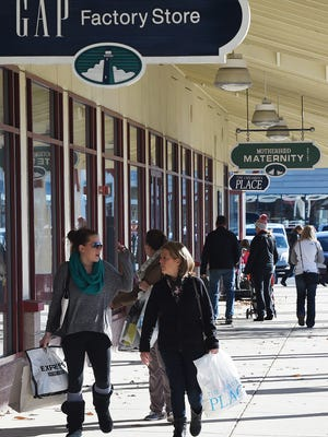 Black Friday shoppers make the rounds at Tanger Outlets.