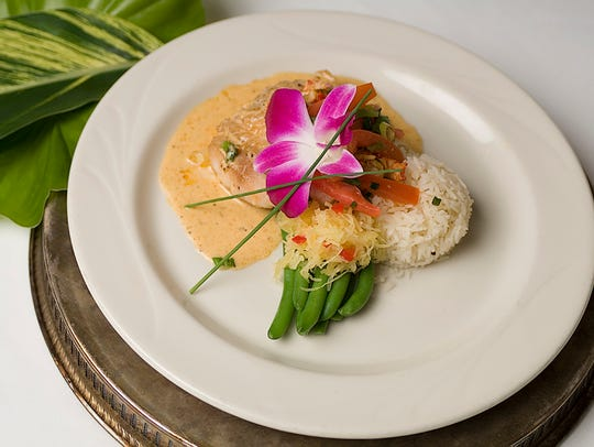 A Champagne beurre blanc sauce tops the basil and Parmesan-encrusted
