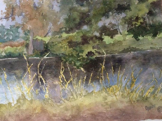 """""""Aunt Florine's Pond #2,"""" a watercolor by Jule McClellan.  She has two paintings in the exhibit from the pond that is a bout a half mile behind the Farmer and The Frenchmen. She said quietness and beauty of the pond is a fascination to her."""