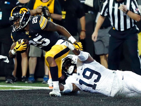 Iowa running back Akrum Wadley, left, is tackled in the end zone by Penn State's Shareef Miller for a safety during the first half of an NCAA college football game Saturday, Sept. 23, 2017, in Iowa City, Iowa. (AP Photo/Jeff Roberson)