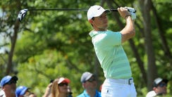 Rory McIlroy of Northern Ireland plays his shot from