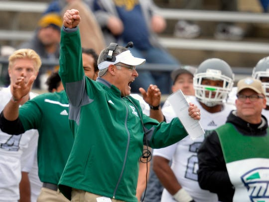 FILE - In this Oct. 17, 2015, file photo, Eastern Michigan head coach Chris Creighton celebrates in the first quarter of an NCAA college football game against Toledo in Toledo, Ohio. Two years ago, it was hard to imagine EMU playing any kind of postseason football game. In fact, it was hard to envision it four months ago. The Eagles haven't played in a bowl since 1987, but that drought finally ends Friday when coach Chris Creighton's team takes on Old Dominion in the Bahamas. (AP Photo/David Richard, File)