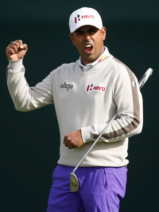 Anirban Lahiri, of India, acknowledges the fans on the 16th hole during the first round of the Phoenix Open golf tournament, Thursday, Feb. 4, 2016, in Scottsdale, Ariz. (AP Photo/Rick Scuteri)