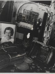 Muriel Hasbun, El altar de mi bisabuelo/ My Great Grandfather's Altar, from the series Santos y sombras/ Saints and Shadows, 1997, gelatin silver print, Smithsonian American Art Museum, Gift of Mr. and Mrs. Charles H. Moore