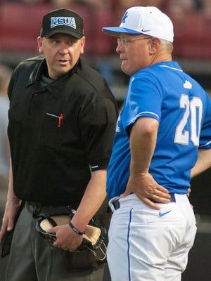 UK head baseball coach Gary Henderson has a talk with the home-plate umpire.19 April, 2016