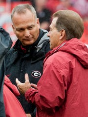 Georgia head coach Mark Richt and Alabama head coach Nick Saban talk before the game at Sanford Stadium in Athens, Ga. on Saturday October 3, 2015.