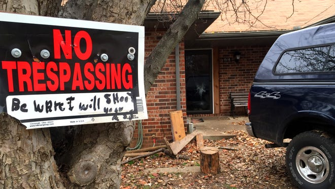 "A sign posted outside Mark Glidewell's Springfield home reads: ""No Trespassing. Beware I will shoot you."""