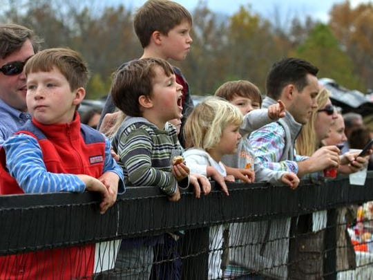 Fans cheer on the riders during the races at the annual Far Hills Race Meeting that includes plenty of tailgating and horse racing, October 18 2014 Warren NJ.