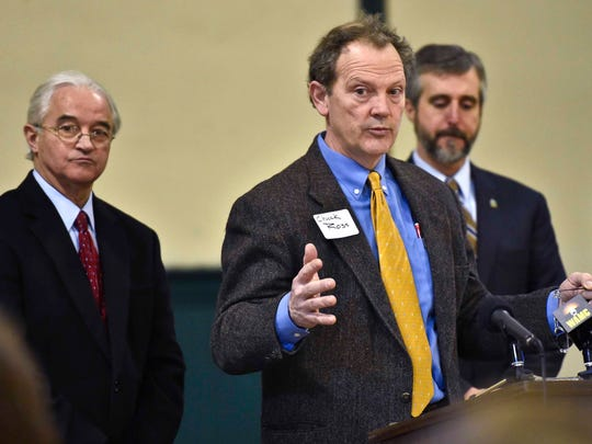 Attorney General Bill Sorrell (from left), Secretary of Agriculture Chuck Ross, and Department of Environmental Conservation Commissioner David Mears answer questions a meeting in St. Albans on Monday, January 26, 2015 on the state's new efforts to improve water quality in Lake Champlain.